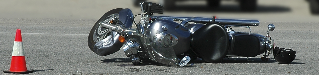 Picture of a motorcycle accident with the bike on its side