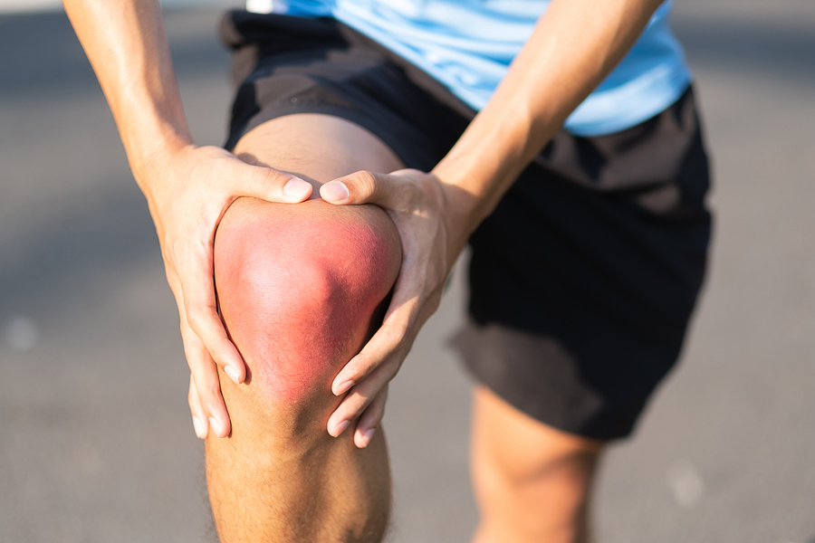 Photo of a Man Flexing His Injured Knee
