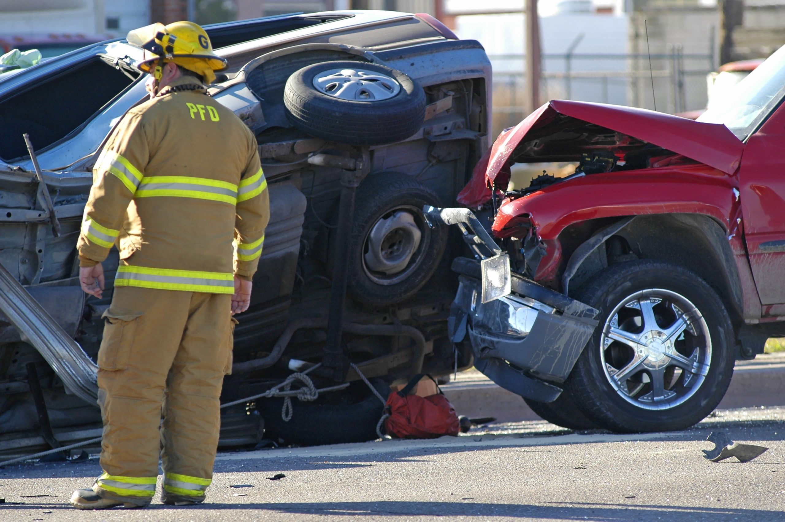 Picture of a two-car accident with a firefighter on the scene